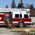 A custom Toyne Aerial fire truck in action.