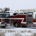 Side view of two Toyne Aerial fire trucks, built to take the call.